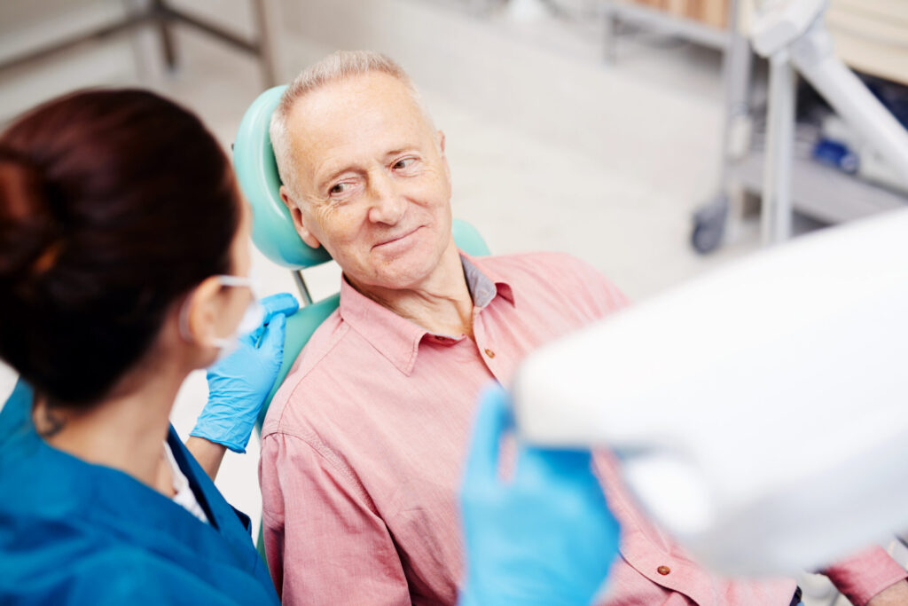 A man comfortably seating at our dental chair